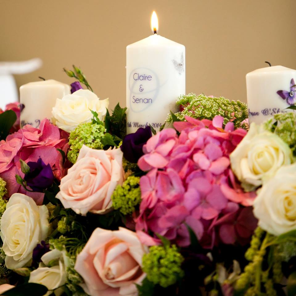 Unity Candle Set among flowers real wedding meaningful wedding ceremony